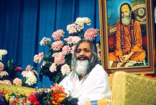 Maharishi Mahesh Yogi. In the background a picture of Guru Dev, his own teacher.